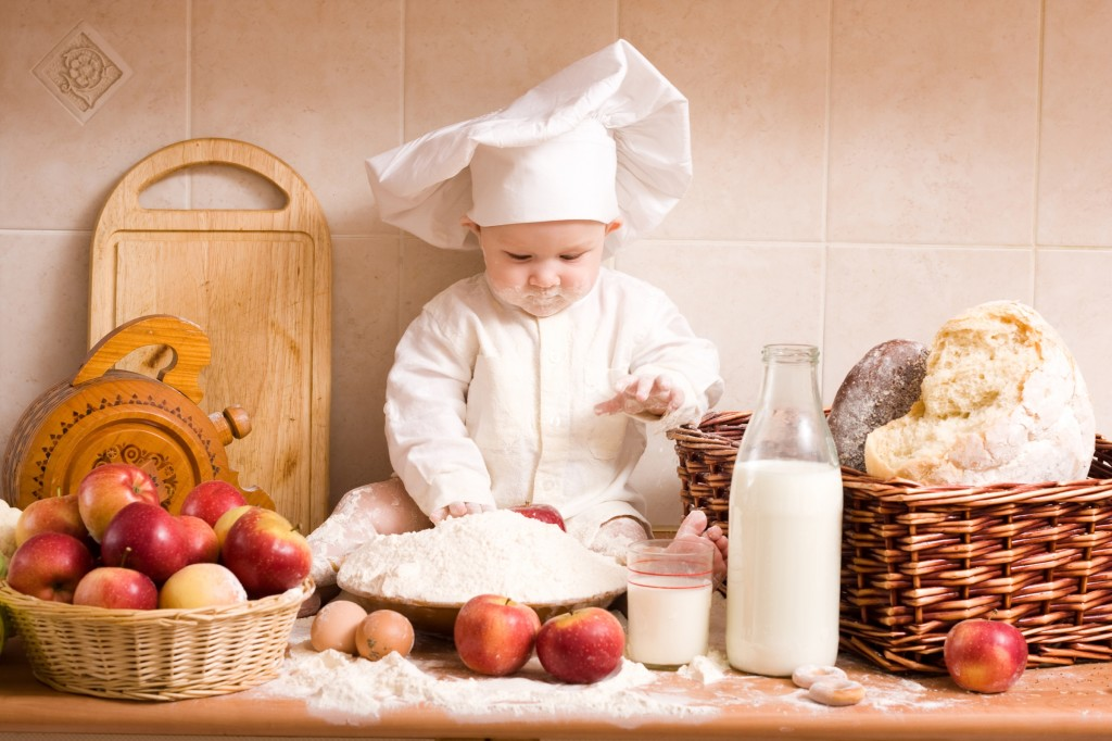 Baby Chef Playing In Kitchen