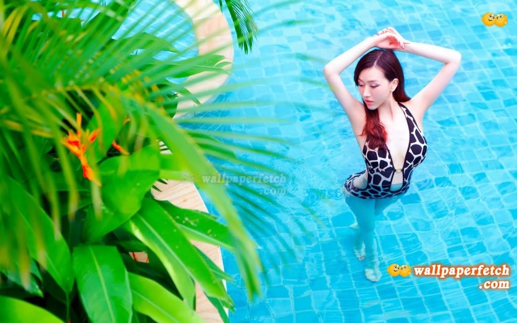 Girl in Swimming Pool Wallpaper